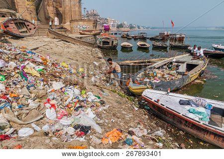 Varanasi, India - October 25, 2016: Pile Of Trash At A Ghat Riverfront Steps Of Sacred River Ganges