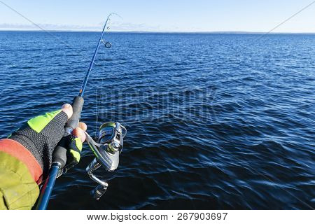 Fishing On The Lake. Hands Of Fisherman With Fishing Rod. Macro Shot. Fishing Rod And Hands Of Fishe