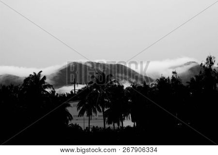 Evening Misty View Of A Mountains. Black And White Pictures