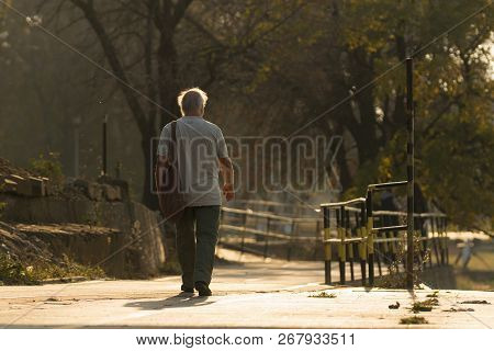 Old Man Walking. Pensioner Lifestyle. Black And White Photo Of An Old Man Walking Lifestyle. Old Peo