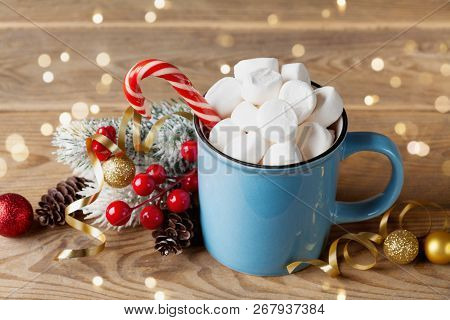 Winter Lifestyle With Cup Of Hot Cocoa With Marshmallows And Christmas Decoration On Wooden Backgrou