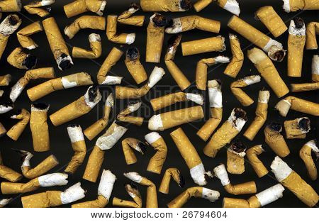 close up shot of cigarettes butt on black