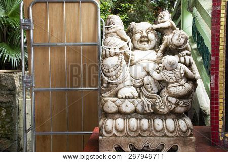 Katyayana or Gautama Buddha or Phra sangkatjay happy and smile Buddha for people respect praying at Tin Hau Temple or Kwun Yam Shrine at Repulse Bay on September 9, 2018 in Hong Kong, China poster