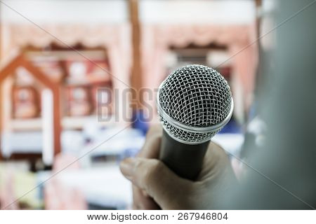 Businesswoman Speech Or Speaking With Microphone In Seminar Hall, Hand Gesturing Protesting Or Belie