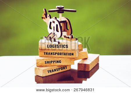 Logistics Transportation Concept : Plane Model With Wooden Blocks For Letter E.g Shipping, Industry,