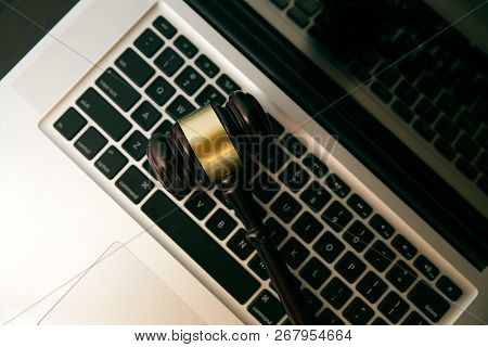 Online Auction Concept. Auction Or Judge Gavel On A Computer Keyboard. Judge Hammer On Laptop Comput