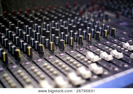 close up shot of an sound mixer buttons