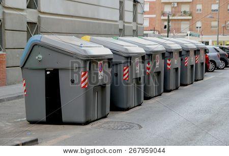Murcia, Spain - August 4 2018: Large Municipal Rubbish Or Garbage Bins On A Spanish City Street