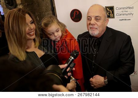 WESTBURY, NY - NOV 8: (L-R) Alexis Roderick, Della Rose Joel and Billy Joel attend the 2018 Long Island Music Hall of Fame ceremony at The Space at Westbury on November 8, 2018 in Westbury, New York.
