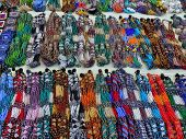 Colorful african arts and craft bead necklace on table poster
