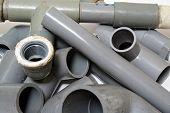 an assortment of pvc piping joints. poster