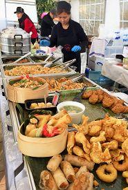 Waterloo, Belgium - November 4, 2018: Thai Street Food. Women Prepare And Serve Authentic Thai Food