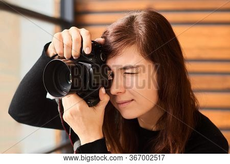 Woman Photographer Taking Photo With Camera On Professional Photo Shoot With Day Light