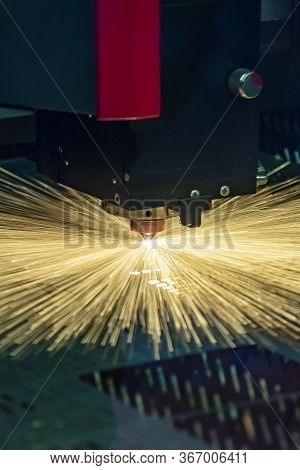 The Vertical Scene Of Fiber Laser Cutting Machine Cutting The Sheet Metal  Plate With The Sparkling