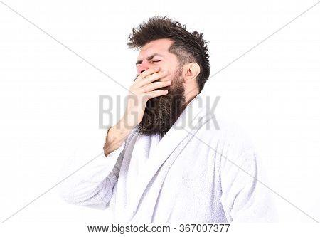 Sleepy Morning Concept. Guy Drowsy With Tousled Hair. Macho In Bathrobe On Strict Face Looks Sleepy.