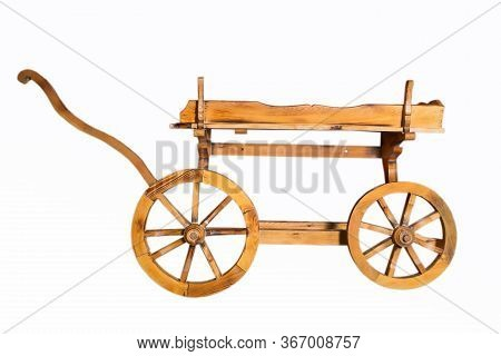 Conservative Ancient Wagon On White Background . Wooden Rustic Four-wheel Cart . Onion In Wooden Car