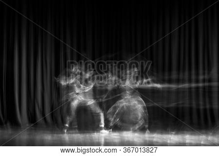 An Artistic Dancer In A Theater Shot With A Slow Shutter Speed In Order To Achieve The Desired Motio