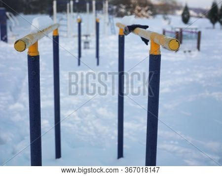 Parallel Bars Covered With Frost, Outdoor Winter Scene