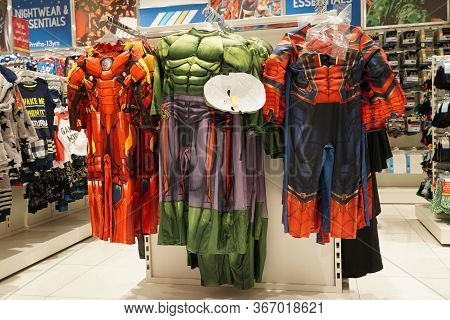 Spiderman, Superman, Ironman Etc Action Figures Costume For Kids Hanging For Sale Inside A Boutique