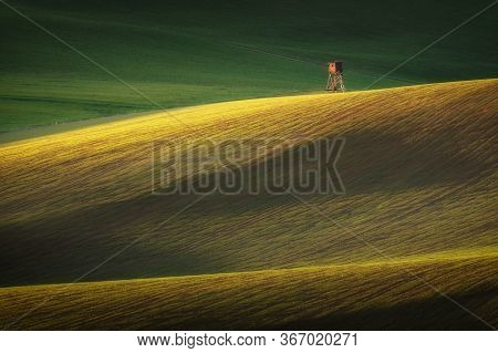 Spring Landscape With Hunting Hide. Fields And Meadows In Turiec Region, Slovakia. Wavy Country Scen