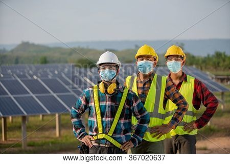 The New Normal Of The Electrical Engineering Team Is Working In A Solar Panel Farm Or Repair Photovo