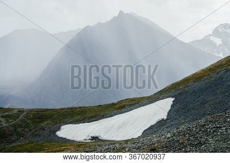 Awesome Alpine View To Huge Mountain With Sharp Pinnacle In Sunbeams Through Clouds. Wonderful Highl