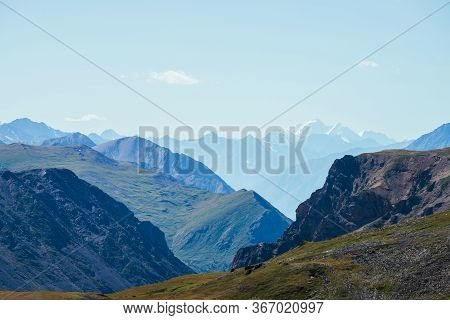 Awesome Scenic View To Great Snowy Mountains Behind Deep Gorge. Wonderful Mountain Landscape With Gi