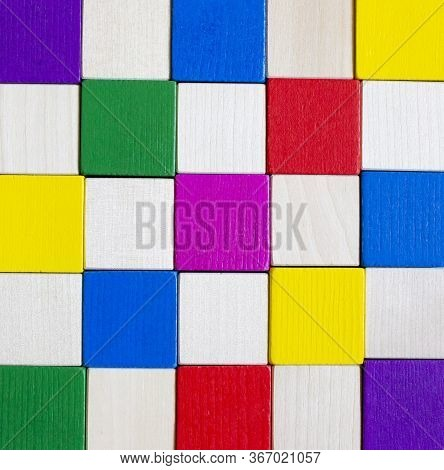 Childrens Wooden Blocks On A Blue Background. Multicolor Game Of Wooden Cubes. Multicolor Compositio