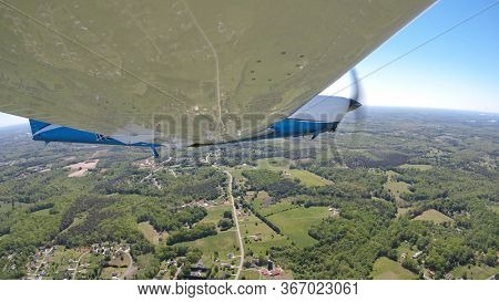 Views of a general aviation aircraft performing maneuvers on the ground and in the air