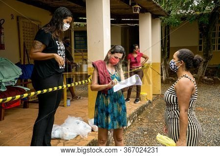 Planaltina, Goias, Brazil-may 16th 2020: A Local Feeding Center In Planaltina, Hands Out Food And Cl