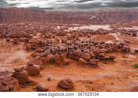 Goblin Valley is a scenic Utah state park, USA. Hoodoo - high thin geological formations. Many funny  figures of red-brown sandstone. The concept of active, informative, ecological and photo tourism