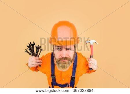 Builder In Construction Helmet. Repairment Tools. Industrial Worker. Repair. Smiling Worker Holds Re