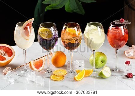Alcoholic And Nonalcoholic Cocktail Drinks With Ice, Fruits, Berries