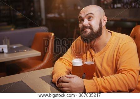 Bearded Man Enjoying Drinking Beer At The Pub
