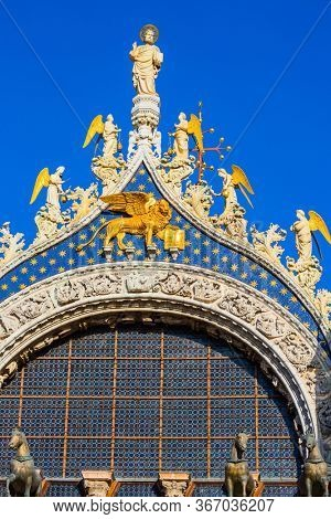 San Marco Cathedral - architectural masterpiece in the Byzantine style. The pediment is decorated with a golden winged Lion - the emblem of Venice. The concept of cultural and photo tourism