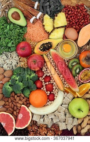Super food for healthy eating with immune system boost to promote vitality, fitness and energy with health foods high in antioxidants, anthocyanins, protein,  omega 3, vitamins and minerals.