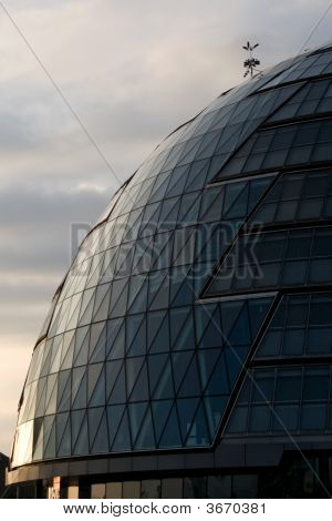 Early Morning Sun Reflecting Off Glass Domed Office Building