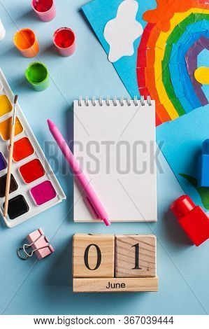 Flatlay Calendar June 1, Notepad Layout For Your Text, Toys, Paints, Rainbow. June 1, World Children