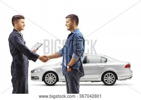 Man taking car to an auto repair shop and shaking hands with auto mechanic worker isolated on white background