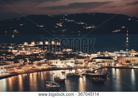 Windmill and bay as the famous landmark at night in Mykonos Island, Greece.