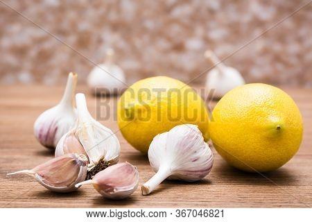 Garlic And Lemon On A Wooden Table. Alternative Medicine. Lower Cholesterol