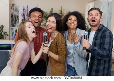 Best Friends Having Fun. Group Of Young Happy Multicultural Friends Singing With Microphone Together