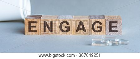 Engage Word Written On Wood Block. Front View. Engage Text On Grey Background For Your Desing, Conce