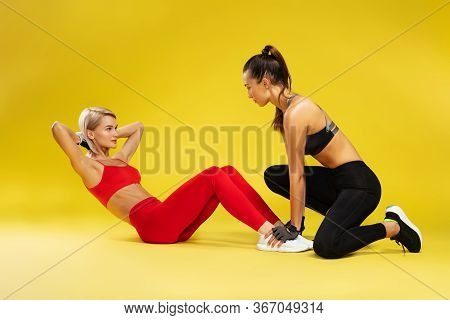 Fitness Exercises. Attractive Sporty Blonde Woman In Red Sportswear Pumping Press, Exercising With P