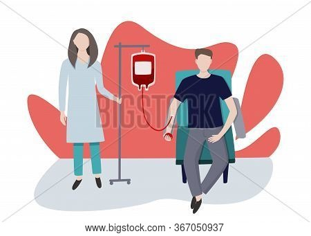 Blood Transfusion Station. Young Man Gives Blood Under The Supervision Of A Nurse.