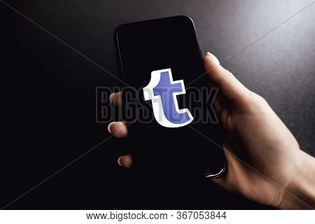 Tumblr Logo. Hands Holding Iphone X With Tumblr App Logo On The Screen.