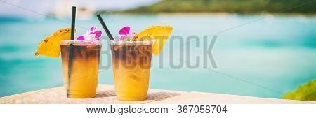 Hawaii mai tai drinks on waikiki beach bar travel vacation in Honolulu, Hawaii. Famous hawaiian drink cocktails with view of ocean and diamond head mountain, Hawaii tourist attraction.