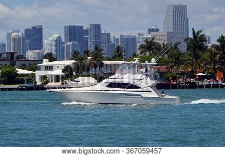High-end White Deep Sea Sport Fishing Boat Cruising By Luxury Miami Beach Island Homes On The Florid