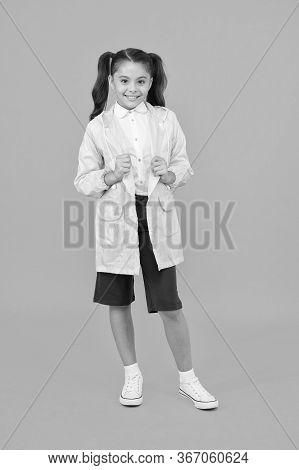 Cute Schoolgirl Feel Protected. Happy Schoolgirl Wear Raincoat. Invest In Durable Kids Rainwear To K