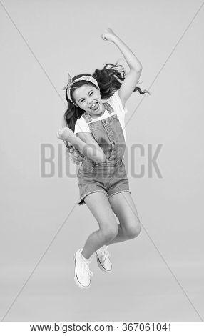 Energy Inside. Feeling Free. Carefree Kid. Summer Holidays. Jump Of Happiness. Small Girl Jump Yello